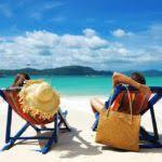Couple Relaxing On Beach Shoreline