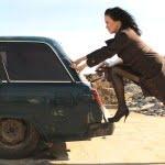 woman pushing run down car