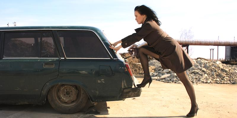 frugal-girl pushes car