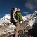 hiker climbing a mountain
