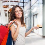 lady with shopping bag and credit card