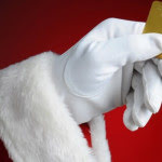 santa holding a gold credit card