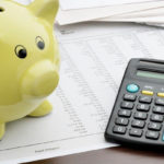 yellow piggy bank with calculator