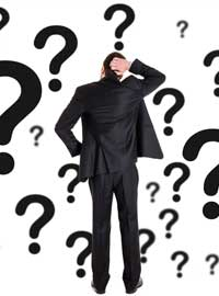 man scratching head with question marks
