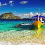 fishing boat near beach shore