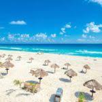 white sand beach huts image