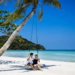 Couple on Swing in Beach