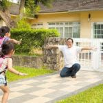Two young girls greeted by father upon coming home