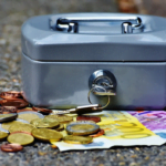 Small safebox with coins and notes