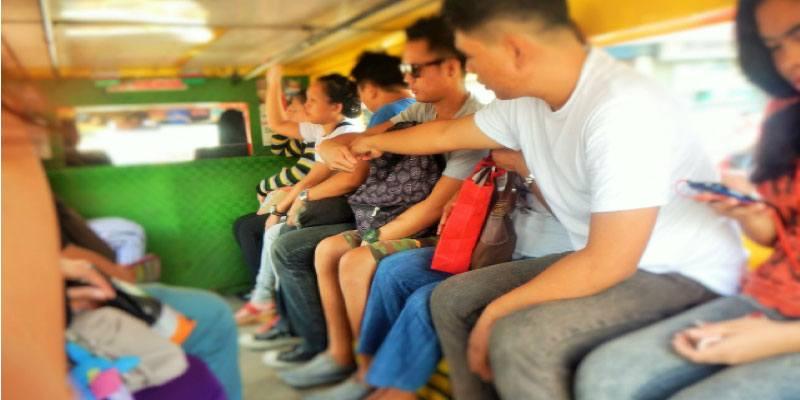 Passengers Inside A Jeepney