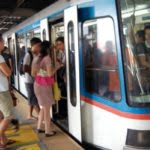 Commuters Boarding The MRT