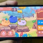 image of a phone running axie infinity fb