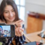 woman posing in front of camera selling live on social media
