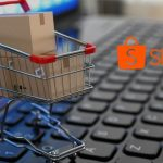 small shopping cart on a keyboard and shopee logo