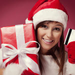 lady Santa with credit card and gift
