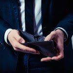 guy looking inside empty wallet