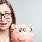 lady in glasses with piggy bank