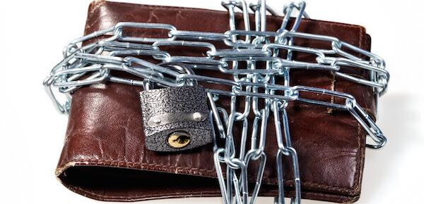 a wallet chained up and padlocked