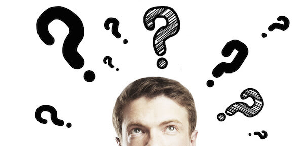 a man with question marks above his head