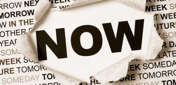 a piece of paper saying 'NOW'