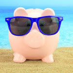 Piggy Bank With Shades in Beach