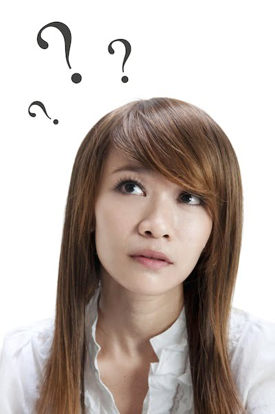 Woman with question marks because of psychology of investment