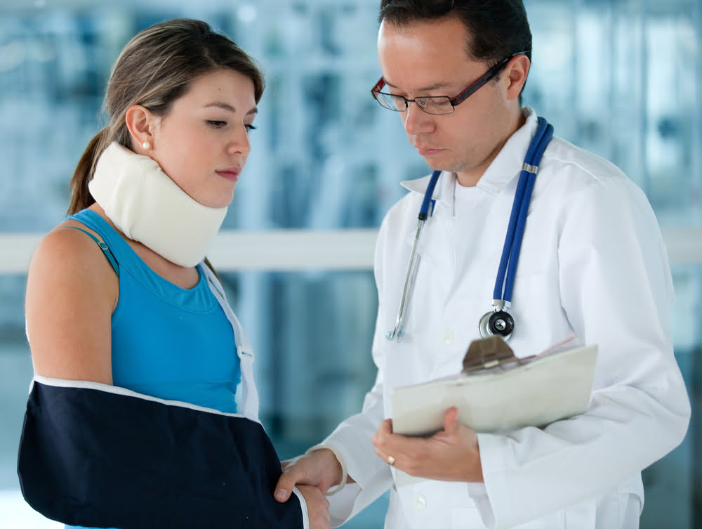 an emergency happened girl in a neck brace checked up by a doctor